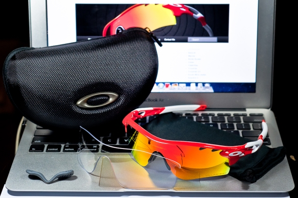 SGD$490 Oakley Custom RadarLock Polarized by wahliao.com Singapore Color: Blood Orange/Fire Iridium Polarized Vented/Clear Purpose: For cyclist, day and night riding Set as pictured.