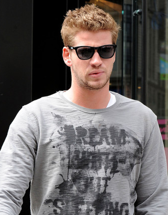 Liam Hemsworth wears Oakley Frogskins