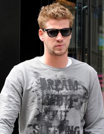 Liam Hemsworth wears Oakley Frogskins