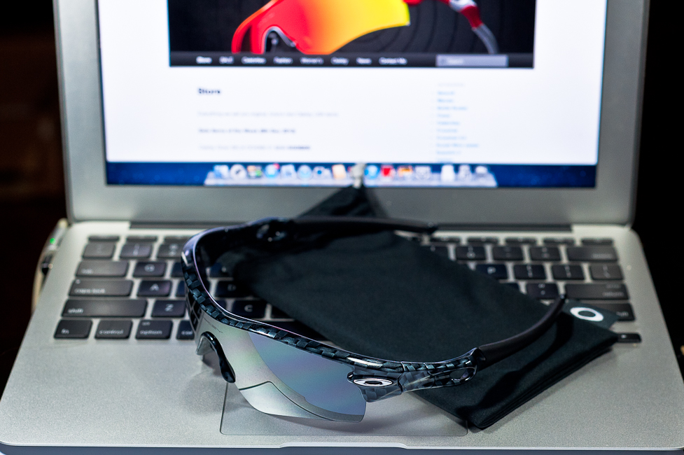 SGD$260 Oakley Custom RadarLock by wahliao.com Singapore Color: Carbon Fibre/Black Iridium. Purpose: For athletes, bright Singapore sun conditions Set as pictured.